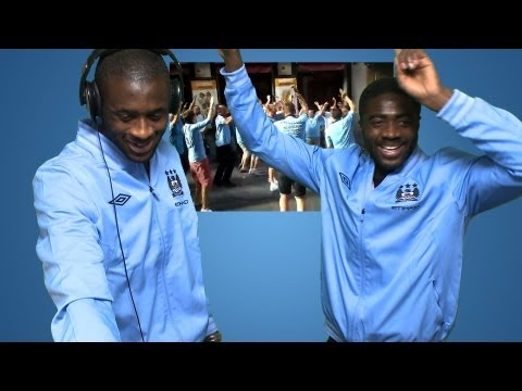 mcfcofficial - Kolo and Yaya Toure listen to the City fans songs about them. Subscribe for FREE and never miss another CityTV video. http://www.youtube.com/subscription_cen...