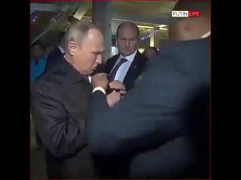 Очень подозрительный охранник Путина (видео)