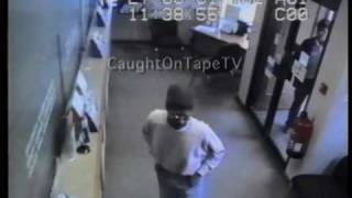 Idiot Bank Robber Thinks He's Stuck in Bank