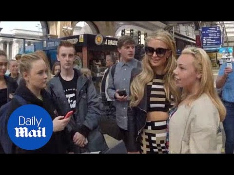 Paris Hilton Arrives Via Train Into Liverpool And Poses With Fans - Daily Mail