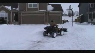 10. Arctic Cat 250 2x4 With City Slicker Snow Plow.