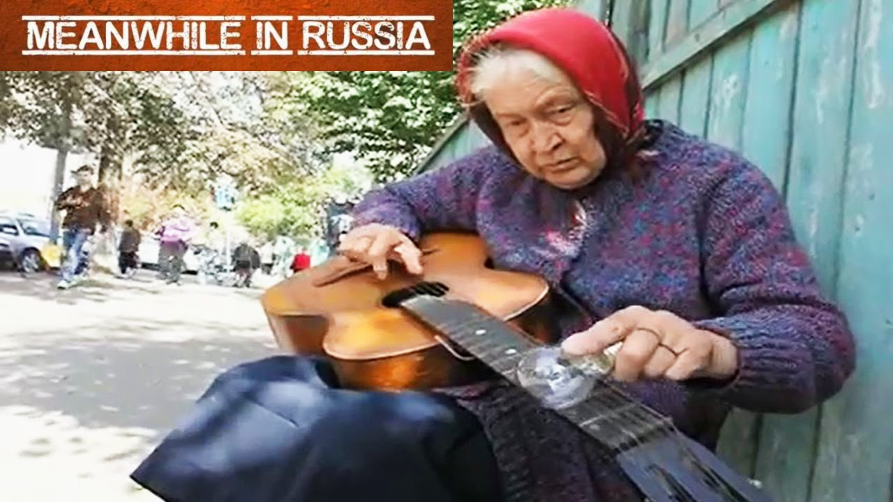 Babushka Plays Guitar Blues With An Electric Bulb