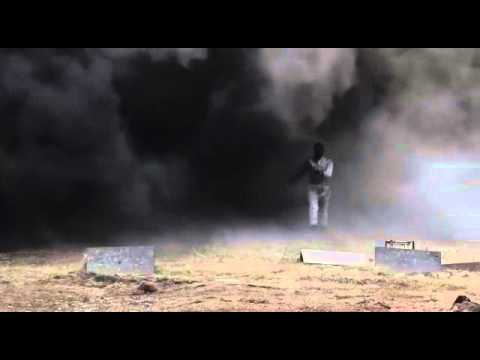 Girl walks through a minefield in a blast proof suit