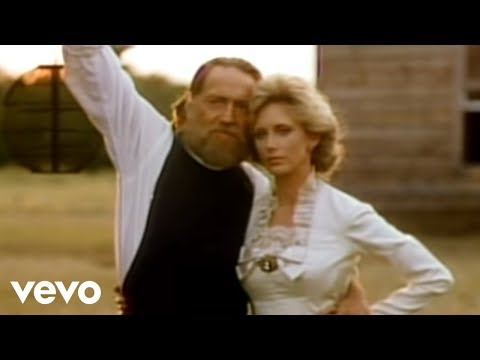 Tekst piosenki Willie Nelson - Blue eyes crying in the rain po polsku