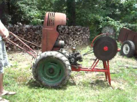 david bradley tractor - My 1953 david bradley with the cordwood saw implement.