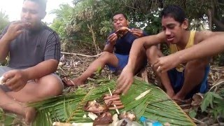 Cooking on the beach Tongan style and Tongans trying to surf, but getting caught in the rip.