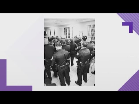 Police officers pray before heading out to help Hurricane Michael victims