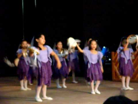 Tambourine dance of praise with the XJ kids