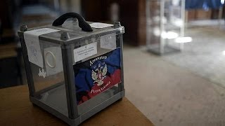Polls open in Donetsk and Luhansk as self-rule vote goes ahead despite Kyiv slamming ballot as...