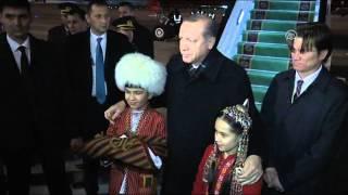 ASHGABAT, TURKMENISTAN - DECEMBER 11: Turkish President Recep Tayyip Erdogan is welcomed by Turkmen children upon his arrival at an airport in ...