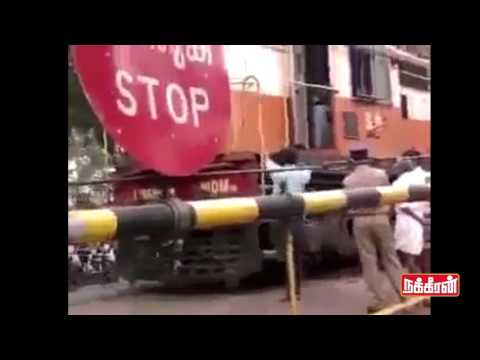 Train-stopped-for-buying-Fishes-in-market-Funniest-shocking-video
