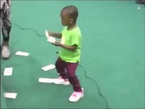 A young Igbo kid spraying money in a party