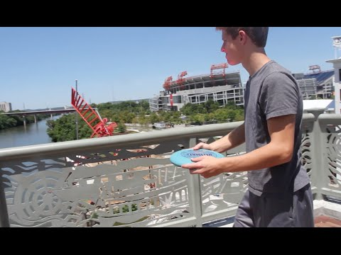 Guy Riding Water Jet Pack Catches Frisbee Tossed Off