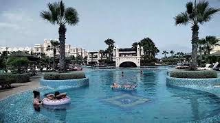 Tour of Riu Touareg Hotel, showing pools, towel creations, spa, pools, poolside activities, themed restaurants, Massive Waves, ...
