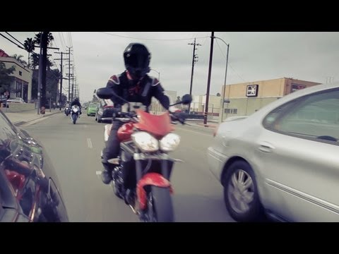 Motorcycle - Motorcycles riding between cars! Calm down, the legal practice of lane splitting saves car drivers time and money by reducing overall congestion while allowi...