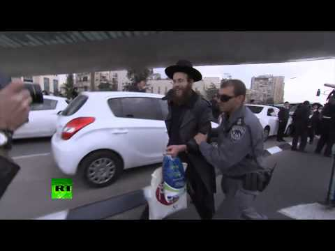 Jews v Cops: Ultra-Orthodox protest against plan to draft th
