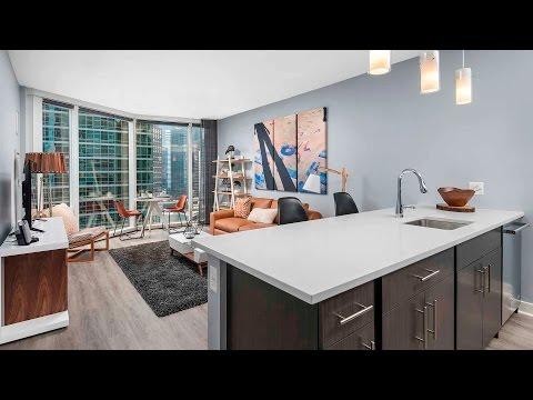 A stylish 1-bedroom model at Streeterville's new Moment apartments