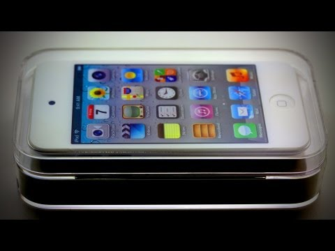 White itouch Unboxing - Buy this iPod Touch here - http://amzn.to/Jd4fPP SUBSCRIBE FOR MORE ON IOS 5! This is an unboxing of the iPod Touch 4G in white. This model still carries the...