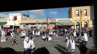 Children dressed in traditional Cornish costume dance in a circle, each holding a coloured ribbon attached to a 4 metre pole. This 18th century pasttime is p...