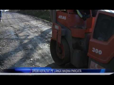 DRUM ASFALTAT PE LÂNGĂ MAȘINA PARCATĂ