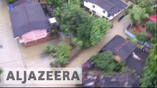 Helicopters are searching for people marooned four days after the worst floods and mudslides in 14 years inundated large parts of...