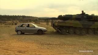 Bil møder kampvogn