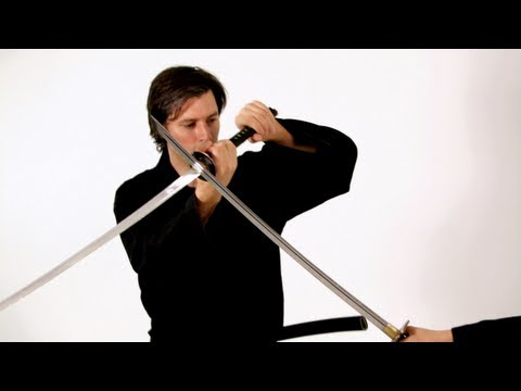 Parry'' - See what you can learn on the go with the new Howcast App for iPhone and iPad: http://bit.ly/11ZmFOu Watch more How to Do Katana Sword Fighting videos: http:...