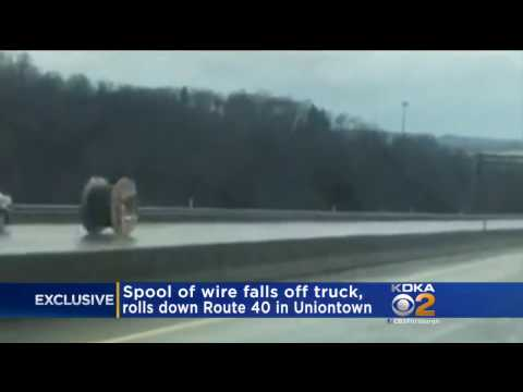 Spool Of Wire Falls From Truck And Rolls Down