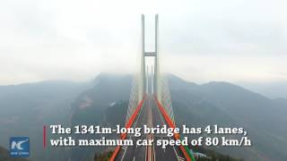 World's highest bridge opens to traffic in SW China's Guizhou. The Beipanjiang bridge, soaring 565 meters above a valley, is part...