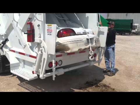 Garbage truck destroys Grand Am