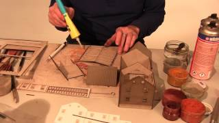 REYNAULDS.COM presents a video on how to build, paint and weather a laser structure in under 50 minutes. Laser structures have been around for many years and many modelers still believe that Laser structures are too hard to build and paint.  These uncertainties prevent many modelers from adding great laser structures to their layouts. Our video shows the process of building, painting, and weathering of an MBZ Laser structure in real-time and how fast and easy it is to build.  CAN YOU BELIEVE it only took the modeler 50 minutes to build, paint and weather the structure?  That is incredible! Most plastic kits take longer than 50 minutes to build. And that does not include painting and weathering.  With a little practice, anyone can build a laser structure.  Once you add a laser structure to your layout you may never consider a plastic kit again.  MBZ Laser structures are simply the best on the market.  The technology used to produce these kits is ingenious. Every item in the MBZ assortment starts out with a high-quality digital graphic and then it gets uploaded into a special software program. The software program then calculates the scale of the structure and which textures will be added, such as roof tiles, grains and bricks. The data then gets sent to a high-powered laser which burns the image onto special cardboard. Everything the camera lens sees will be re-produced in the model. For instance, if the original structure has a cracked shudder, the laser will re-produce it in the model. The technology is rather simple and the results are amazing. Plastic and wooden kits do not compare to the innovative details that you will find in a MBZ laser structure. Try a MBZ item today and see for yourself. Nothing comes close to the detail and quality of a laser cut structure.MBZ Structures are available in HO, TT, N, O, and Z Scale