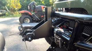 8. Kymco uxv  500 snowplow modification