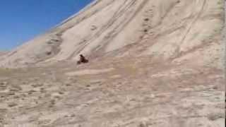 7. Little Max shredding the desert on his KDX 50