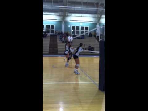 Maddie Engeler with a kill during the 2012 ECAC Tournament Quarterfinal win over Albertus Magnus