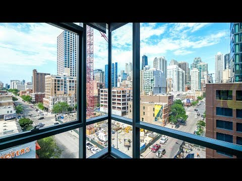 A large 04-tier corner 1-bedroom at River North's new SixForty apartments