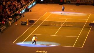 A lucky young man plays some balls with Roger Federer after his victory against Juan Martin Del Potro.