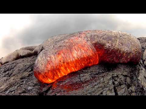 Sexiest video of lava flow you will see up extreme close. You almost feel like poking your finger in it.