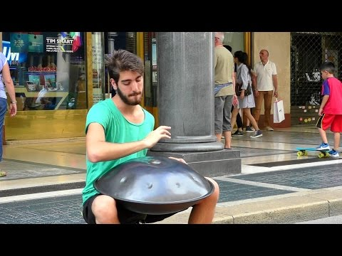 Street Music in Italy. Playing the Hang Instrument. Steelpan. Seen in Turin