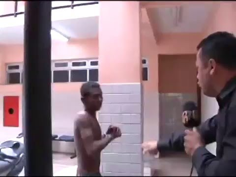 Guy spits on reporter's face after being arrested. Gets punched in the face.