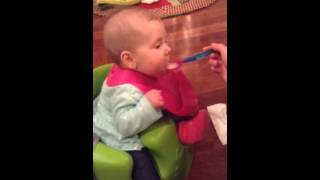 Funny - Baby eating Cereal for First Time