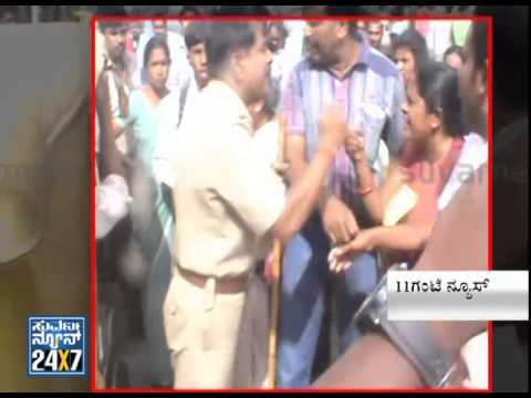 CPI Shivakumar manhandles a women in Kolar - News bulletin 24 Jul 14