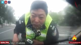Xuzhou China  city pictures gallery : WATCH : Police Officer in Xuzhou, China is seen being dragged for two kilometers by a car