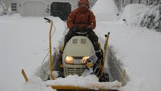 8. Cub Cadet Tractor-mounted Snow Thrower Operating