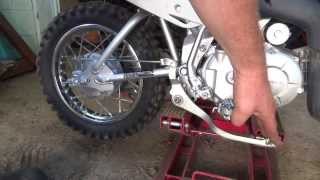 5. dooin some service to the Honda crf 110f dirtbike