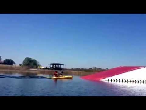 Extreme kayaking up a water ski ramp!