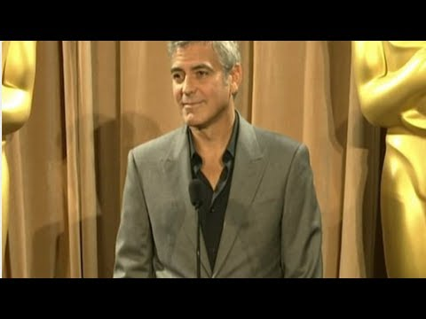 "George Clooney Says He and Brad Are Not ""Always at the Hilton Drinking Champagne"""
