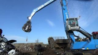 Terex Fuchs MHL350E material handler dealing with scrap metal for LKM Recycling
