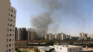 There has been heavy fighting between rival militias near the airport of the Libyan capital Tripoli. Explosions and gunfire were ...