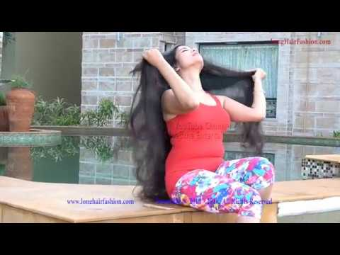 Romantic Long Hair Beauty Playing With Her Tresses