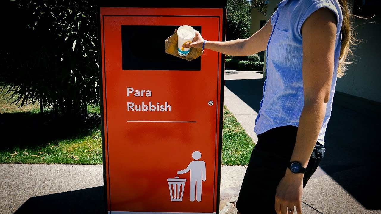YouTube placeholder image shows person dropping rubbish into a smart bin.